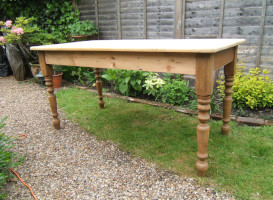 stripped and sanded wooden table